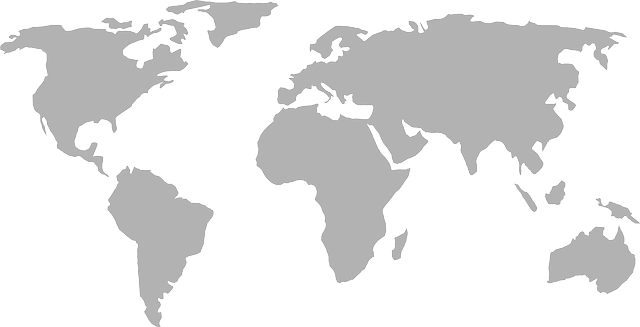 Grey map of the world with transparent background around the land masses