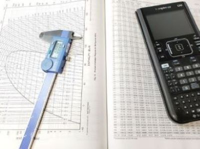 Calculator-and-Caliper-Sitting-on-Top-Pressure-Enthalpy-Chart-homepage-400x292
