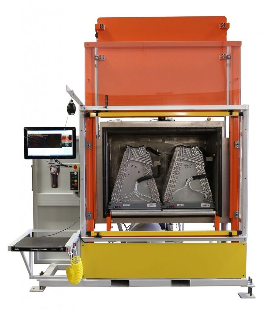 An alternative leak testing system that employs a vacuum chamber