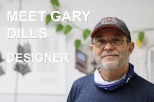 A portrait of Gary Dills, who drafts mechanical engineering drawings of leak detection systems at Vacuum Technology Incorporated.